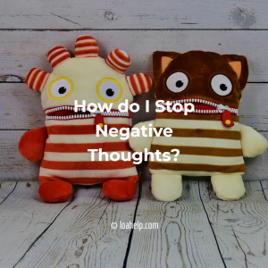 How do I stop negative thoughts? Two knitted dolls are looking like they could use some advice about thinking more positive.